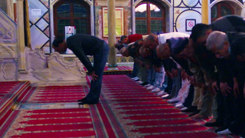 Muslim men praying at a mosque filmed in Israel.