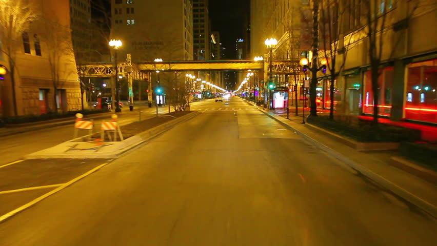 CHICAGO, ILLINOIS, USA - CIRCA 2011; Driving down the city street