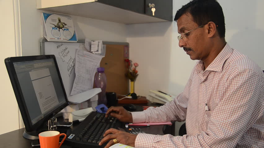 Image result for man on computer india