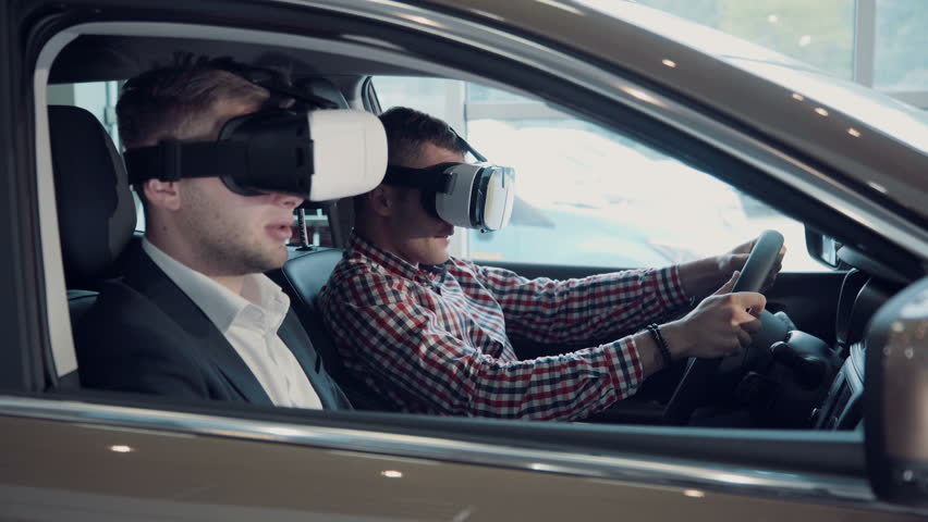 Instructor and man in glasses to pass virtual exam for driver license using virtual reality glasses. | Shutterstock HD Video #20234377