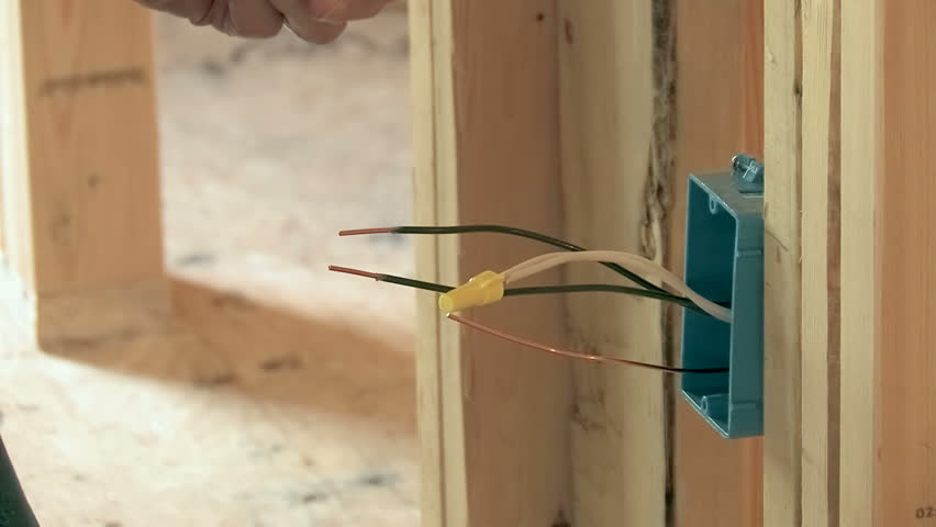 Electrician Wiring Wall Outlet Box In New Construction Stock Footage ...