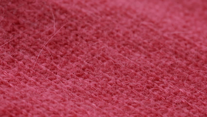 Red woolen worsted sweater pattern. can use as background.