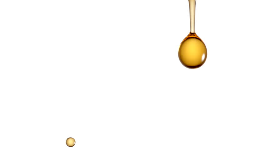 Droplets of oil falling. Slow Motion.