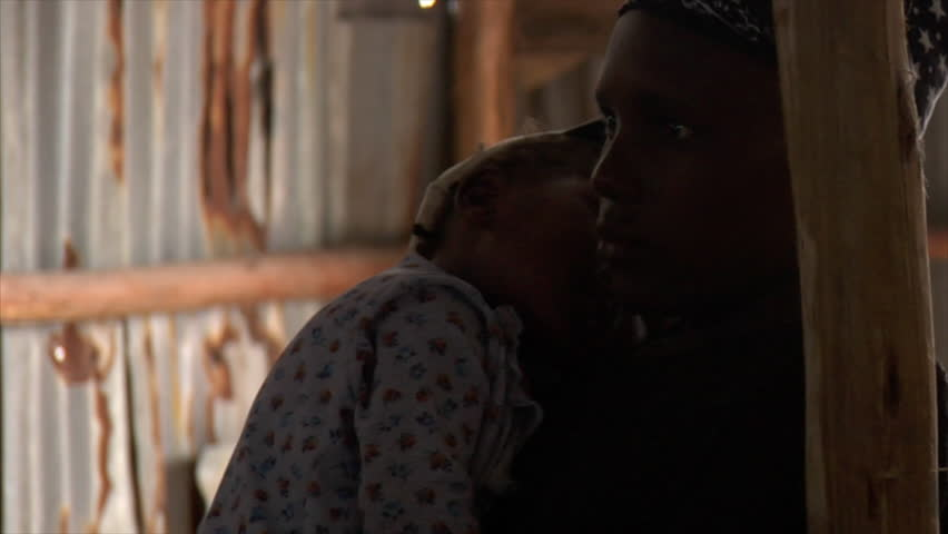 KENYA - CIRCA 2006: Silhouette of unidentified girl and her baby circa 2006 in Kenya. #2024518