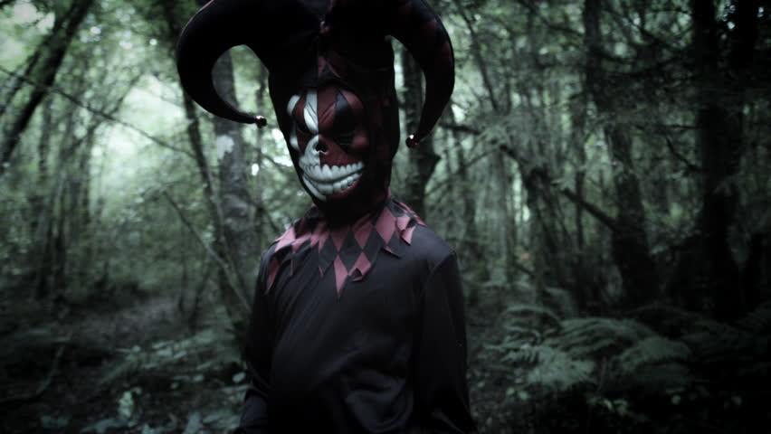 4k Halloween Shot of a Child in Joker Costume Moving Creepy Fingers
