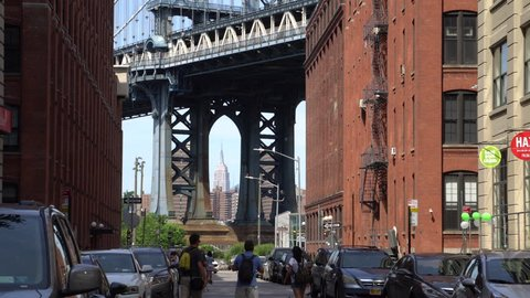 The Manhattan Bridge Viewed From Dumbo, Brooklyn with the Empire State Building framed in the bottom of the bridge arch support structure. Medium Street Shot (New York City, August 2016)