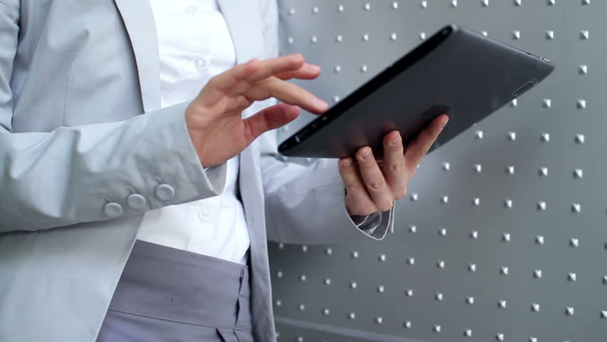 Young businesswoman working on tablet computer, camera stabilizer shot | Shutterstock HD Video #2031298