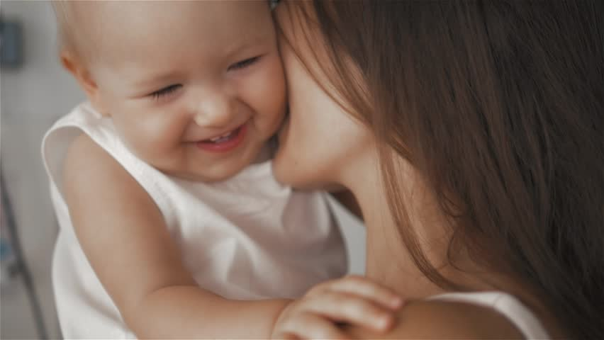 Mother and Baby. Happy Family. Mom With her Child smiling and laughing at home.   Shutterstock HD Video #20356015