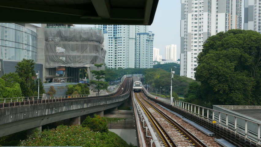 SINGAPORE - April 05, 2016: 4K footage of People in MRT train. The Mass Rapid Transit or MRT is a rapid transit system forming the major component of the railway system in Singapore.