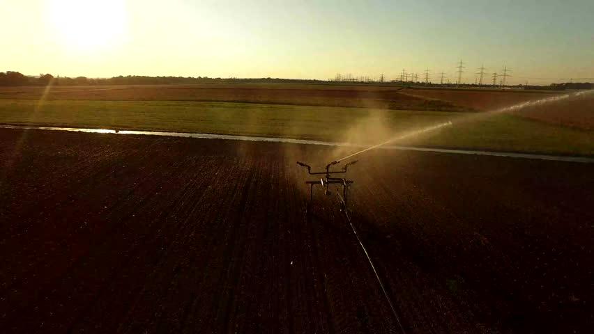 4K Aerial video footage: Industrial irrigation of a salad field, germany | Shutterstock HD Video #20402758