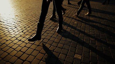 Shadows of people walking in city