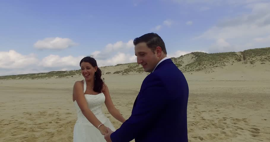 Loving happy wedding couple at the beach | Shutterstock HD Video #20446888