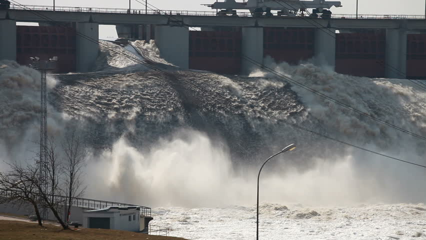 Spring flood water flowing on hydroelectric power station dam | Shutterstock HD Video #2045921