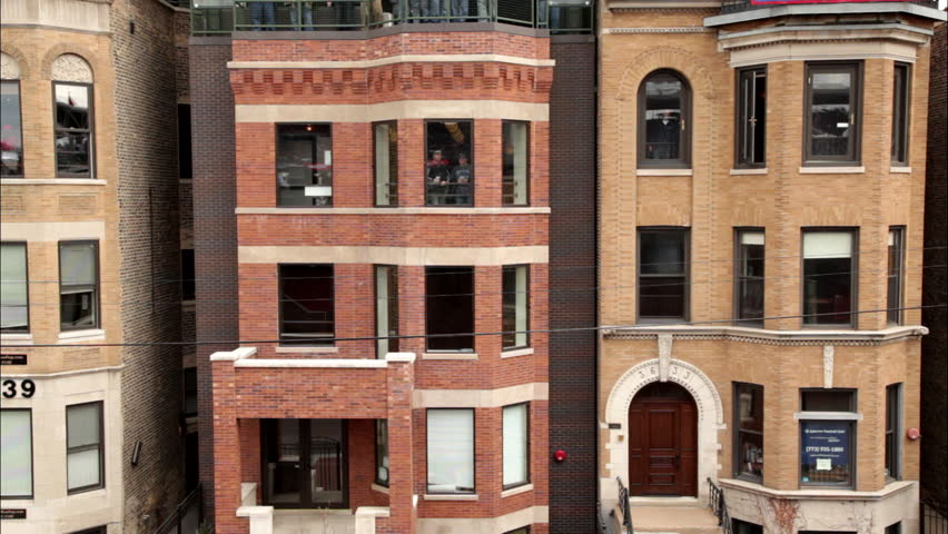 Brick Apartment Building Window a typical new york-style apartment building establishing shot