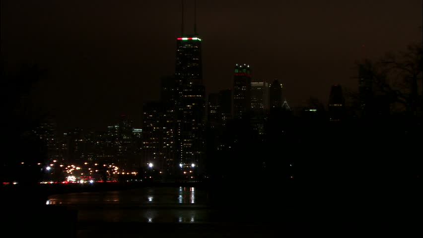 night hold across river water Chicago skyline red green accent Christmas lighting, bushes rfg, foggy