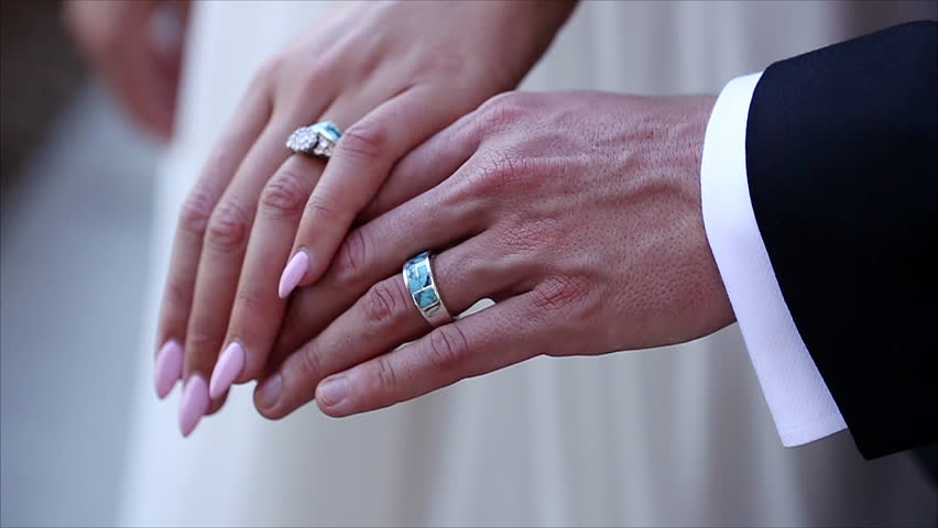a bride and groom are wearing their wedding rings hd stock video clip