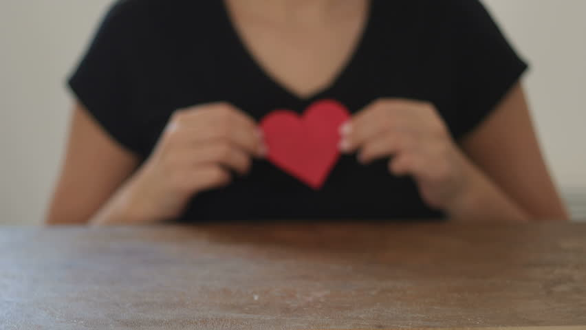 Female hands holding red paper heart, Valentine's Day | Shutterstock HD Video #20502118