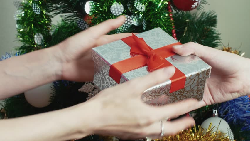 Christmas Giving.Hands Of Girl Giving Gift Stock Footage Video 100 Royalty Free 20544418 Shutterstock