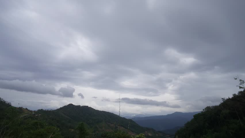 Time lapse of dramatic cloud storm over hilly landscape valley of beautiful Sabah Malaysian Borneo.