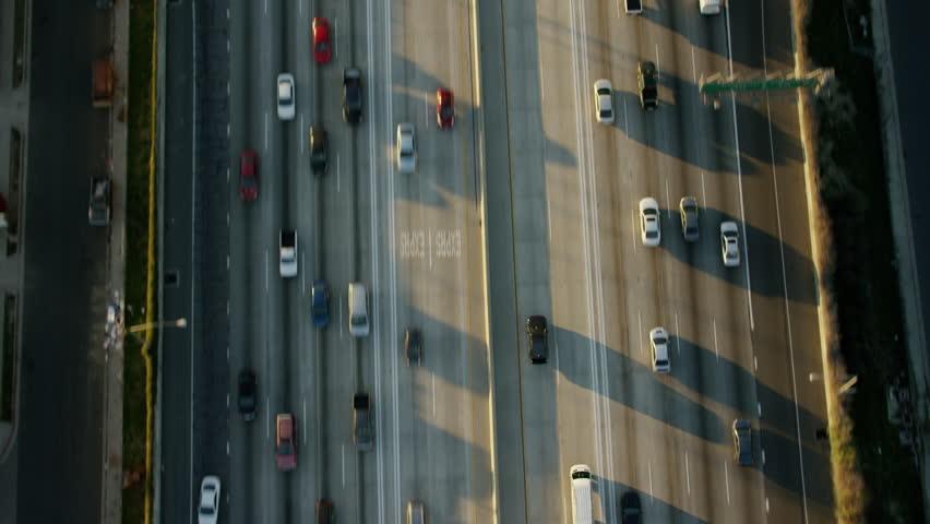 Aerial sunrise California City Logistics Freeway vertical traffic trucks commuter Express Lane Toll travel Highway