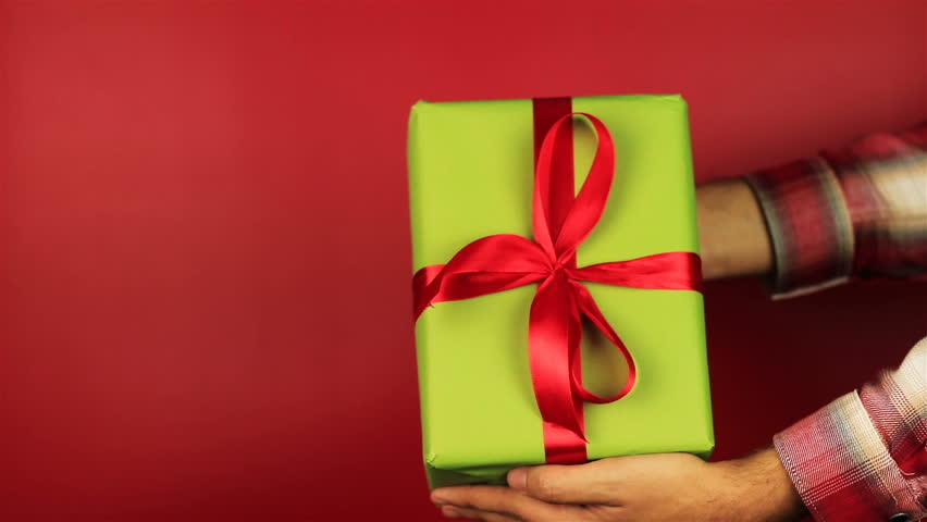 Stock video clip of young man gives a gift on red shutterstock negle Gallery