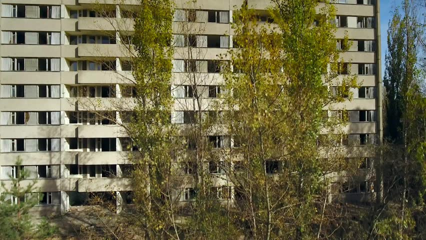 Ascending view of abandoned apartment complex in Pripyat Town after meltdown of Chernobyl nuclear power plant nearby in 1986. Plant workers & family were forced to evacuate & never return. Oct 2016.