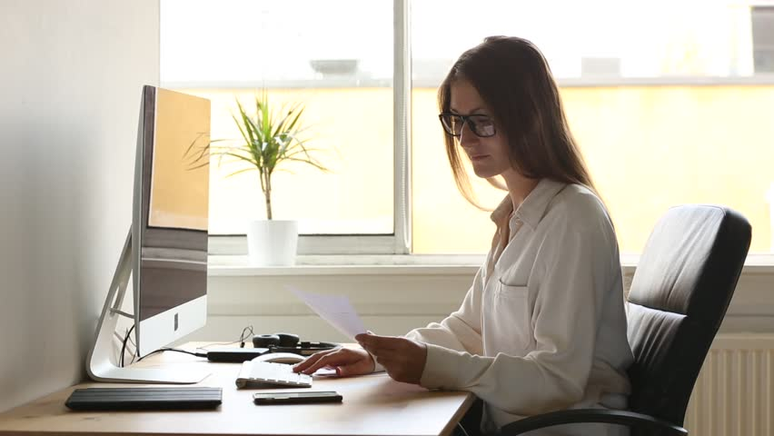 Young Woman at Work, Writing Stock Footage Video (100% Royalty ...