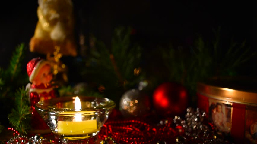 Christmas celebration background. Christmas, advent collage with tree branches, candle, gift box, christmas balls and decoration. Candle light closeup at background of christmas decoration. #20626219