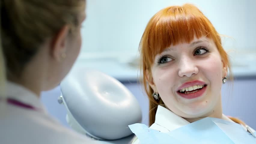 Health and Dental Care, Woman at Work as Dentist and Doctor, Meeting with Assistant and Talking with Young Female Patient in Professional Laboratory.