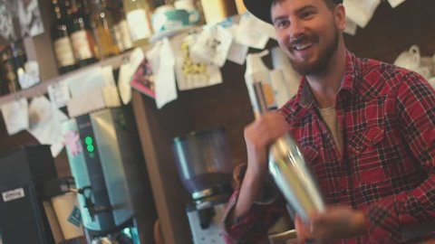 Portrait of a smiling bartender. Bartender preparing cocktail. Cocktails. bartender job. The bartender shakes a shaker. Agility. Art bartender