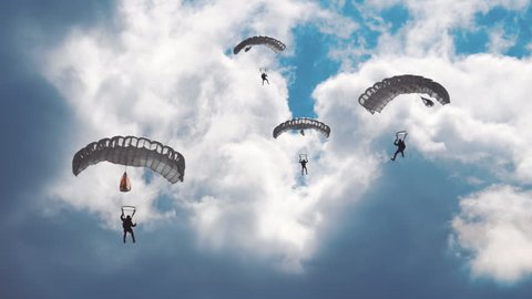 Military parachutists lands on a background of clouds and blue sky