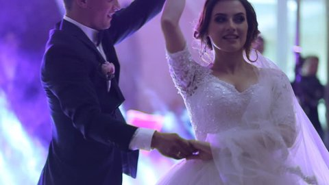 Just married couple is dancing at wedding party