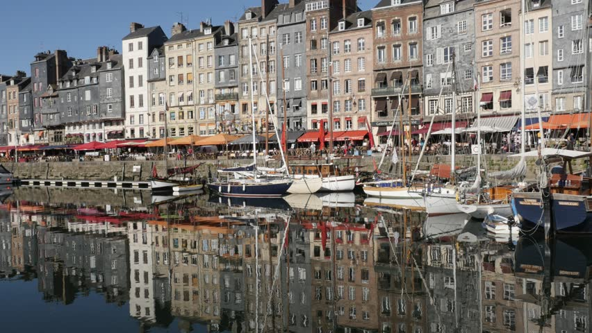HONFLEUR, FRANCE - SEPTEMBER 2016: Beautiful Northern Normandy and The Vieux Bassin with port water reflections of buildings by the day footage