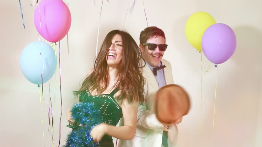 Sexy woman and handsome man having awesome time dancing in party photo  booth, graded