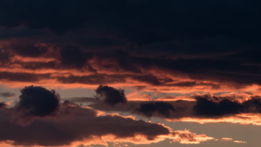 Timelapse shot of evening cloudscape at sunset. Dark clouds sailing in the sky #20804428