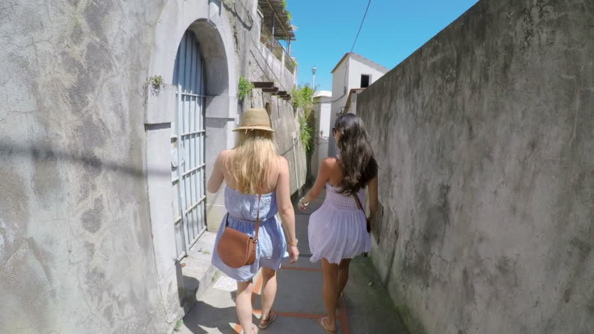 Pov Women travelling in beautiful Italy relaxing summer vacation exploring to discover coastal Amalfi interacting laughing Gopro