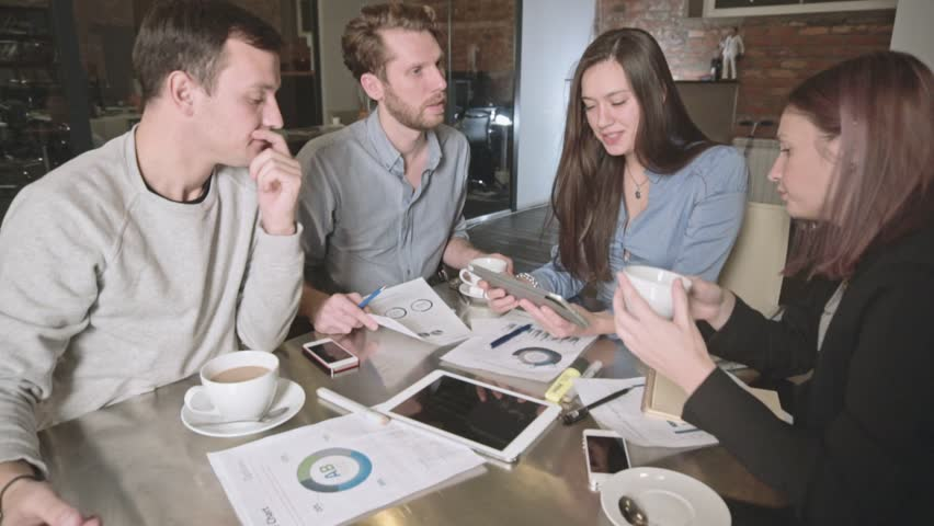 Group of young people in business meeting showing teamwork. Startup | Shutterstock HD Video #20878948