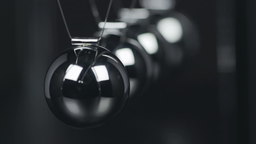 Slow motion shot of a Newton's Cradle. | Shutterstock HD Video #20922658