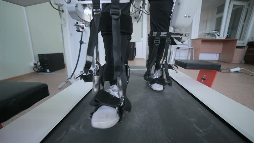Man with innovative robotic VR cybernetic system walking like a robot. Hi-tech game industry and motion tracking in cyberspace.