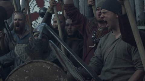 WOLIN, POLAND - 06.08.2016: Army of Vikings Screaming before the Battle during Slavs and Vikings Festival. Medieval Reenactment. Shot on RED Cinema Camera in 4K (UHD).