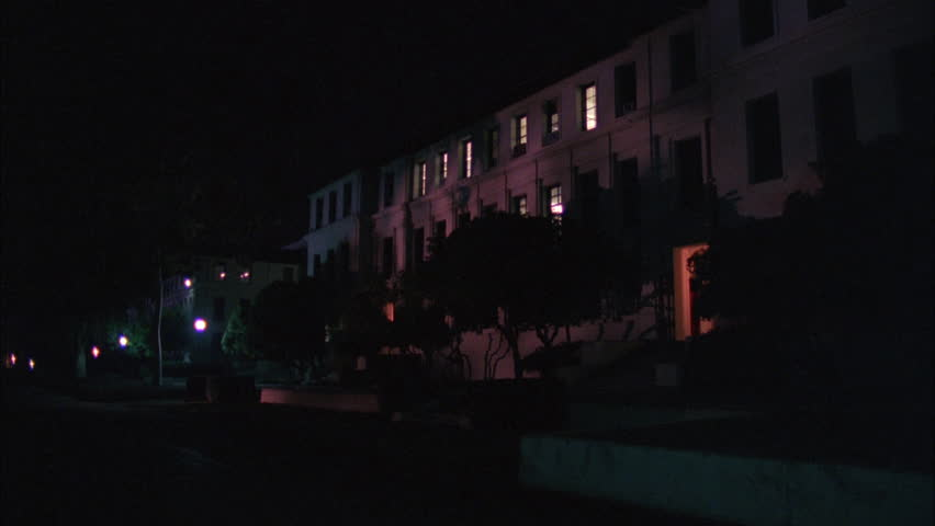 night ND Raked right nice long 3 story stone building dorm eastern college campus, could be military barracks