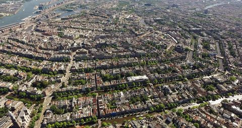 Aerial of the inner city of Amsterdam, with its canals and old mansions. Highlights in the center Prinsengracht, Herengracht, Keizersgracht and in the background the IJ and the Central Station.
