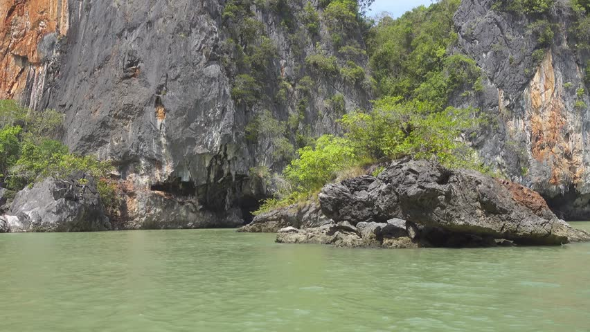 Kayaking between the rocks and caves in Thailand 4k | Shutterstock HD Video #20986588