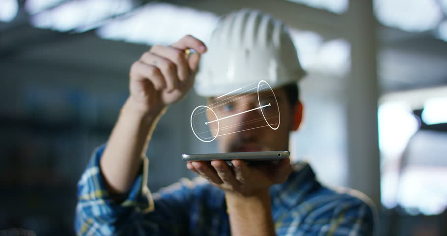 A worker uses a future technology platform to verify the design in holography and augmented virtual reality. Concept: future technology, multimedia technology, futuristic engineering. #20989348