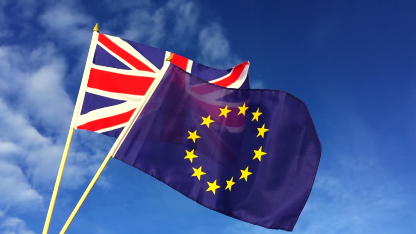 European Union and British Union Jack flag flying in front of bright blue sky in representation of the Brexit EU referendum