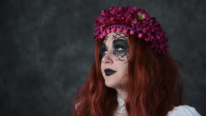 Portrait of young woman wearing high fashion makeup with crown of flowers | Shutterstock HD Video #21011848