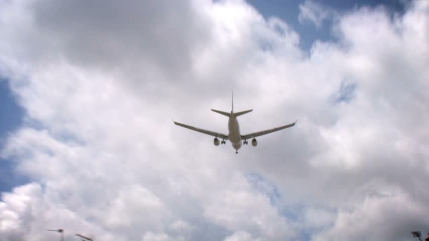 Aircraft 01, HD Passenger airplane on landing approach across a cloudy sky.