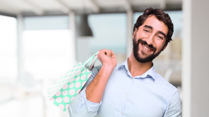 Young man with shopping bags at home | Shutterstock HD Video #21043018