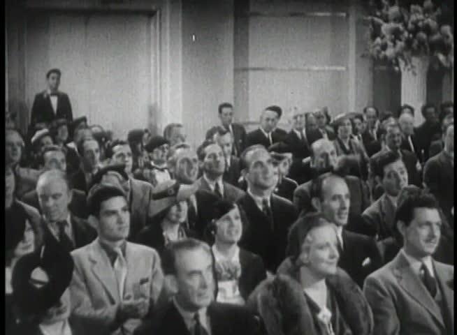 Wide shot of 1930s audience applauding | Shutterstock HD Video #2107169