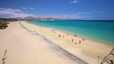 FUERTEVENTURA, FRANCE - August 28, 2016 - Costa Calma sandy beach with vulcanic mountains in the background, Jandia, Fuerteventura, Canary Islands, Spain.